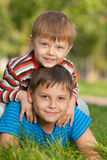 Two smiling brothers on the grass Royalty Free Stock Photo