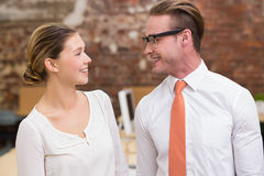 Two smiling business colleagues in office Stock Photos