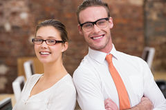 Two smiling business colleagues in office Royalty Free Stock Photography