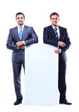 Two smiling business man showing blank signboard Royalty Free Stock Photos