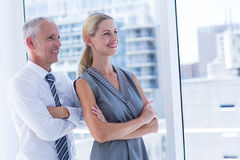 Two smiling business people looking away Royalty Free Stock Images