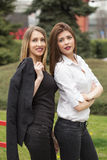 Two smiling business women. Standing, outside Royalty Free Stock Photography