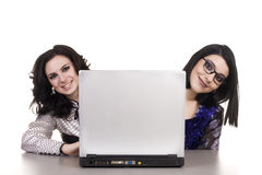 Two smiling businesswomen with laptop Royalty Free Stock Photos