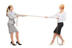 Two smiling businesswomen pulling rope Royalty Free Stock Photography