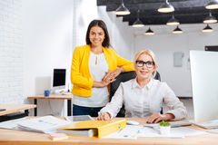 Two smiling businesswomen working together in office Stock Photos