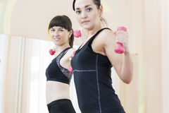Two Smiling Caucasian Sports Women Exercising With Barbells Stock Photos