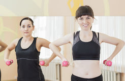 Two Smiling Caucasian Sports Women Exercising With Barbells Indoors Royalty Free Stock Photo