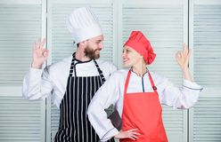 Two smiling chefs in kitchen. couple in love with perfect food. man and woman chef in restaurant. secret ingredient by. Two smiling chefs in kitchen. couple in stock photos