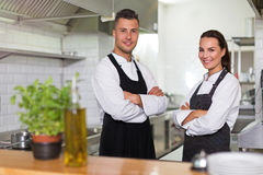 Two smiling chefs in kitchen Royalty Free Stock Image