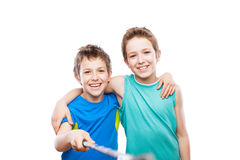 Two smiling child boy brothers holding mobile phone or smartphone selfie stick taking portrait photo Royalty Free Stock Photography