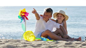 Two smiling children  looking aside stock video footage