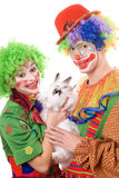 Two smiling clown. With a white rabbit Royalty Free Stock Image