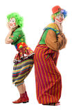 Two smiling clowns are back to back Royalty Free Stock Photography