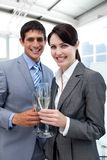 Two smiling colleagues drinking Champagne Stock Photos