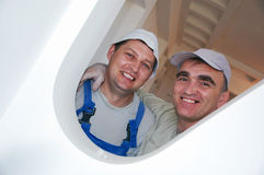 Two smiling construction workers Stock Photos