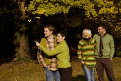 Two couples in autumn park Royalty Free Stock Photo