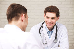 Two smiling doctors discussing something Royalty Free Stock Image