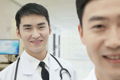 Two Smiling Doctors in Hospital, portrait Stock Image