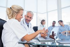 Two smiling doctors looking at a laptop Royalty Free Stock Image