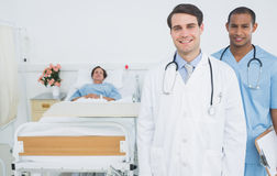Two smiling doctors with patient in hospital Royalty Free Stock Images