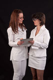 Two smiling female medical doctor discussing together on medical Royalty Free Stock Photo