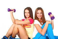 Two smiling fitness girls with dumbbells Stock Photography
