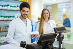 Two smiling friendly pharmacists working Stock Photos