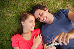 Two smiling friends looking at photos on a camera Royalty Free Stock Photography