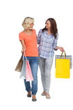 Two smiling friends with shopping bags Royalty Free Stock Image