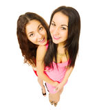 Two smiling funny girls Royalty Free Stock Image