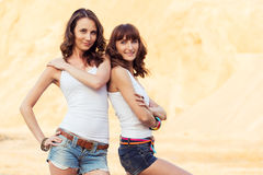 Two smiling girl on beach Royalty Free Stock Images