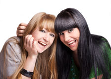 Two smiling girl-friends Royalty Free Stock Photo