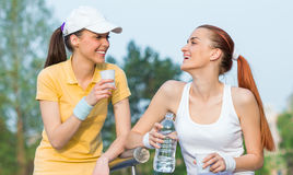 Two smiling girl friends in sports clothing Royalty Free Stock Image