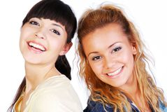 Two smiling  girlfriends Royalty Free Stock Photos