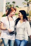 Two smiling girlfriends Royalty Free Stock Photography