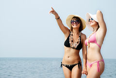 Two smiling girls on beach Royalty Free Stock Images