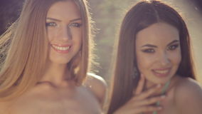 Two smiling girls in bikini posing in jewelry stock video