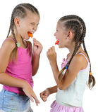 Two smiling girls with candy. stock photo