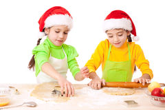 Two smiling girls with Christmas cooking Stock Image