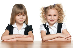 Two smiling girls at the desk Stock Image