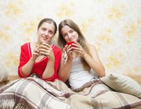 Two smiling girls have tea Royalty Free Stock Images