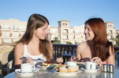 Two smiling girls having lunch Royalty Free Stock Image