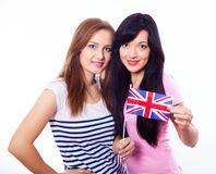 Two smiling girls holding British flag. Stock Photography