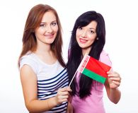 Two smiling girls holding flag of Belarus. Royalty Free Stock Images