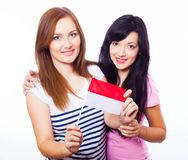 Two smiling girls holding Monaco flag. Royalty Free Stock Photos