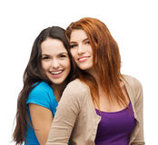 Two smiling girls hugging Stock Photos