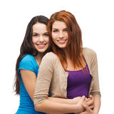 Two smiling girls hugging Royalty Free Stock Images