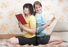 Two smiling girls indoors Stock Photos