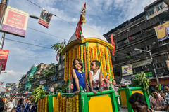 Two smiling girls riding Lord Jagannath chariot. Royalty Free Stock Photos