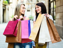 Two smiling girls with shopping bags Royalty Free Stock Photo